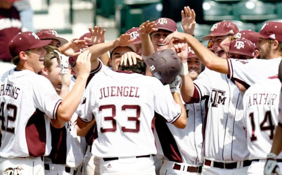 Texas A&M players congratulate designated hitter Matt Juengel on his three-run homer during the seventh inning against Texas Tech.