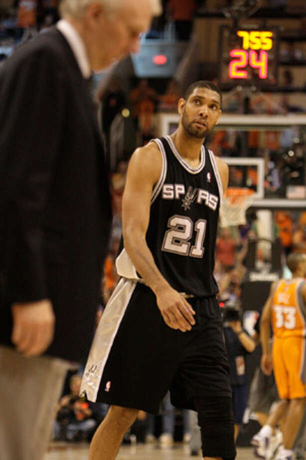 Spurs forward Tim Duncan (right) and coach Gregg Popovich have returned from Phoenix facing a 2-0 deficit, and Duncan admits, ?It?s a must-win for us in Game 3 at home.?