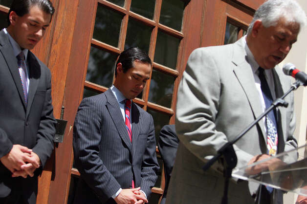 District 5 city councilman David Medina, Jr. and Mayor Julian Castro bow their heads as Soapy Dollar, right, organizer of National Day of Prayer says a Prayer of Dedication and Adoration. / spoecial to the San Antonio Express-News