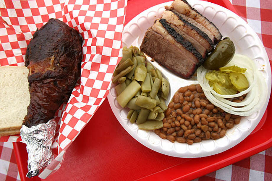Get several of the restaurant's best items -- turkey leg, brisket, green beans and baked beans -- on the combo plate.