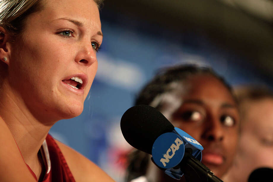 Jayne Appel, Stanford University center, answers a question during team interviews at the Alamodome.  Next to her is forward Nnemkadi Ogwumike. / glara@express-news.net