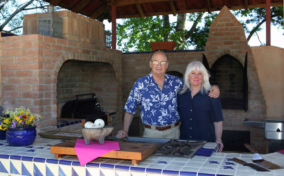 Mexican and Tex-Mex cuisine expert Jim Peyton and his wife, Andrea, spend lots of time in their outdoor kitchen at their home near Government Canyon. / jdavenport@express-news.net