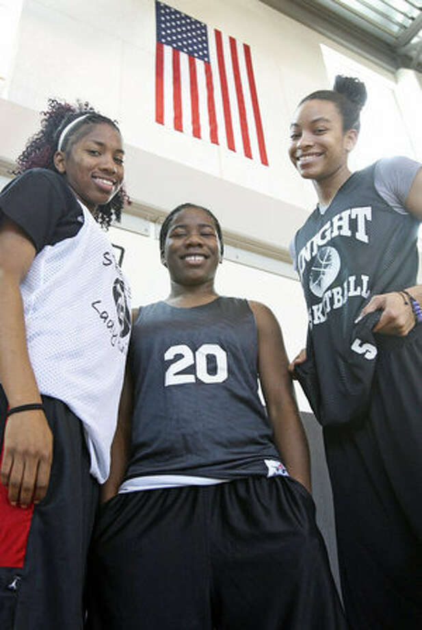 Steele players Domonique Smalls (from left), Olivia Patterson and Angela Johnson each have deployed military parents who won't be able to attend their state semifinal game.