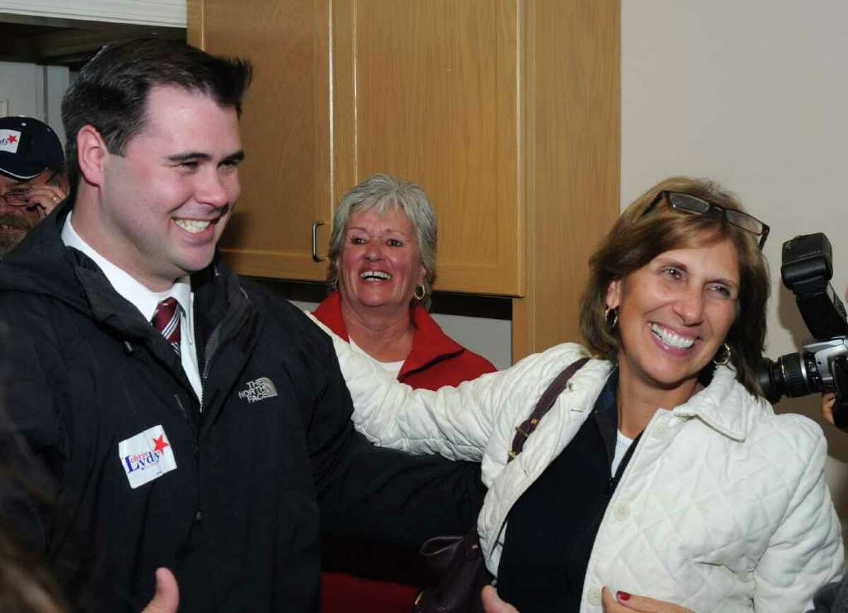 Democratic candidate, Chris Lyddy, arrives at the Democratic Headquaters in Newtown, after winning the 106th District, State Representive race, on Tuesday, Nov. 11, 2010. He is greeted by supporter, Lil Martenson, right, as his aunt, Kate Berarducci , center, looks on.