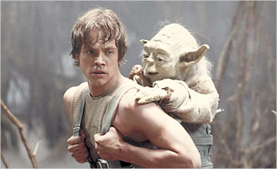 Luke Skywalker (Mark Hamill) and Yoda on the swamp planet Dagobah.