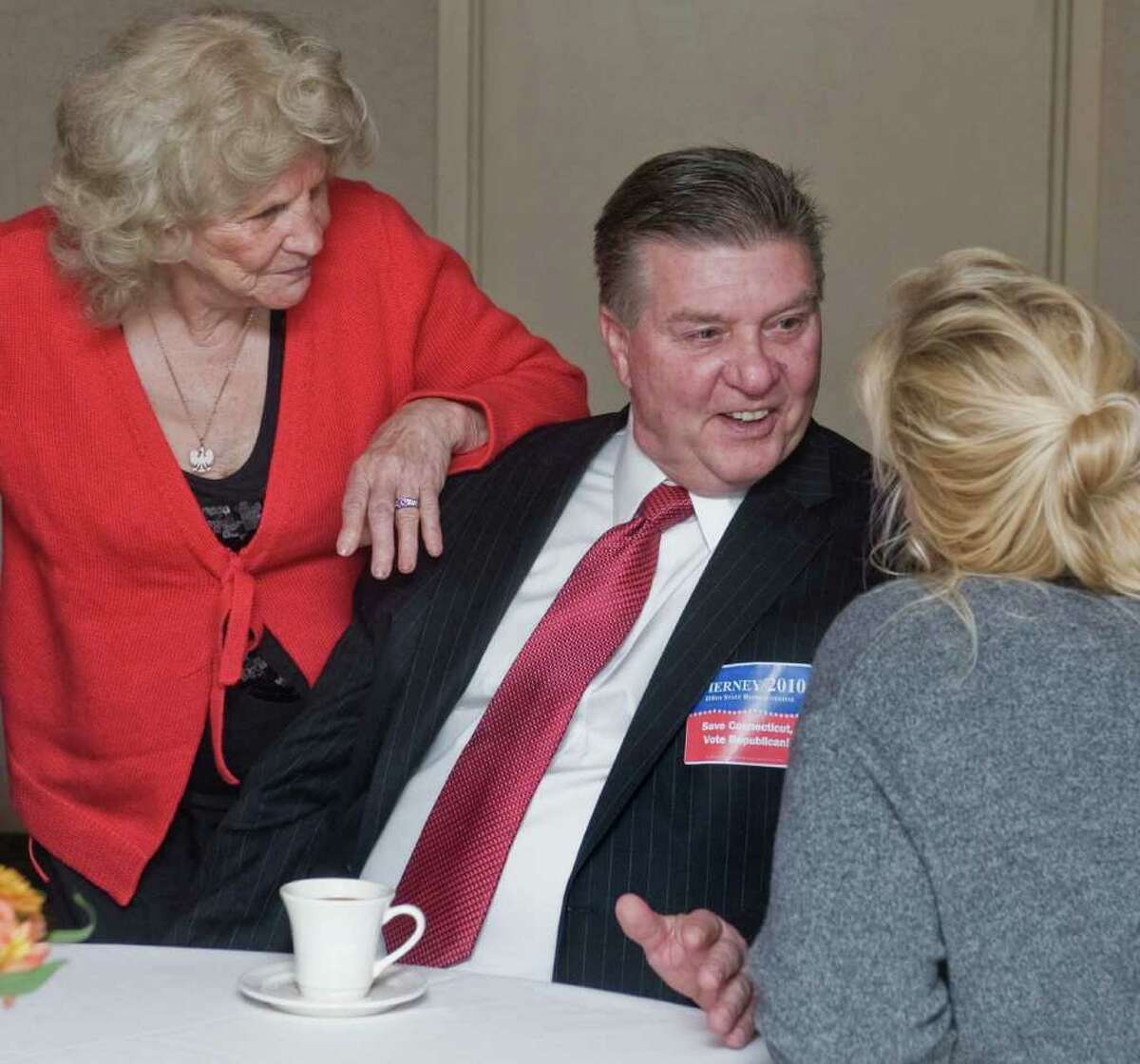 Lydia Yaglenski, 33 years on the Danbury Republican Town Committee, leans on candidate Terry Tierney for the 110th district as he chats with Cindy Palanzo of Danbury at the Republican Headquarters in the Maron Hotel. Tuesday, Nov. 2, 2010