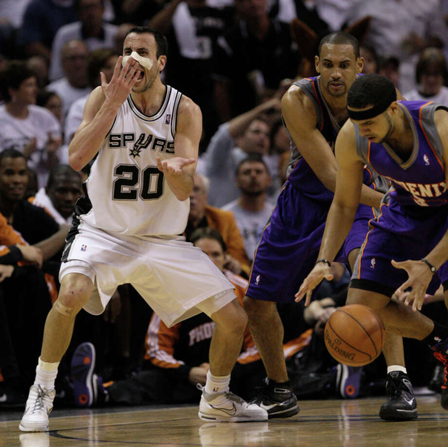 San Antonio Spurs Manu Ginobili claims a foul as Phoenix Suns Grant Hill, center, and Jared Dudely steal the ball in the second half. / glara@express-news.net
