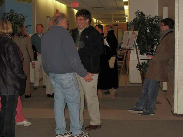 Residents wait at Darien Town Hall as election results began to trickle in Tuesday evening. Photo: File Photo / Darien News