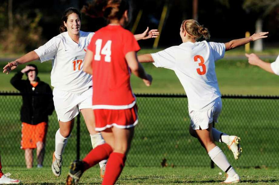 High school soccer -- Kristina Maksuti, left, senior forward for the Bethlehem, runs to her twin sister and fellow team captain Marjana Maksuti, right, as they celebrate Kristina's goal late in the second half that put the Eagles up 2-0 against Guilderland. (Luanne Ferris / Times Union) Photo: Luanne M. Ferris