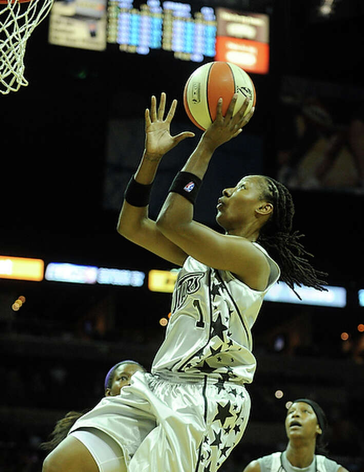 Chamique Holdsclaw drives and scores her first points as a Silver Star during WNBA action against the Los Angeles Sparks at the AT&T Center on Saturday.