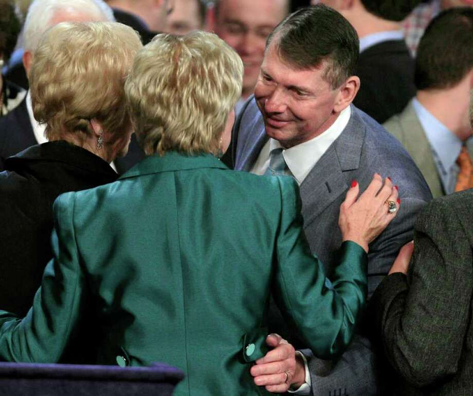 Connecticut Republican U.S. Senate candidate Linda McMahon, left, is embraced by her husband Vince during her election night party in Hartford,  Conn. Tuesday, Nov. 2, 2010.  Richard Blumenthal, Connecticut's longtime Democratic attorney general, won the state's hotly contested U.S. Senate race. (AP Photo/Charles Krupa) Photo: Charles Krupa, AP / AP