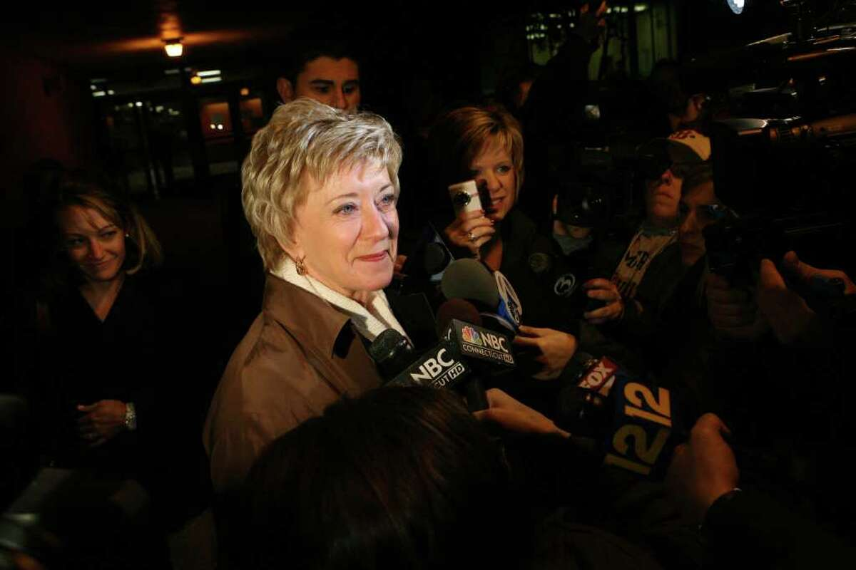 U.S Senate candidate Linda McMahon answers questions from the press after voting at North Street School in Greenwich early Tuesday morning,.