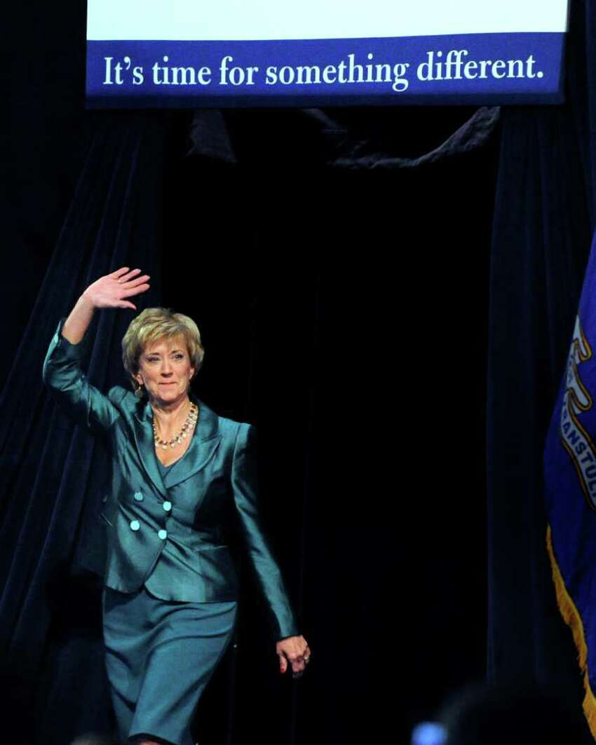 Republican candidate for U.S. Senate Linda McMahon waves as she enters the hall just before giving concession speech at the Connecticut Convention Center, Hartford, Conn., Tuesday night, Nov. 2, 2010. Democrat Richard Blumenthal has been unofficially declared the winner.