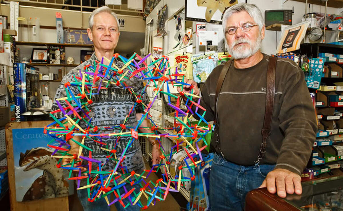 Co-owners of Analytic Scientific Ltd., 11049 Bandera Road, Jim (left) an Doug Aldrich hold a Hoberman Sphere, just one of many geeky delights they sell.