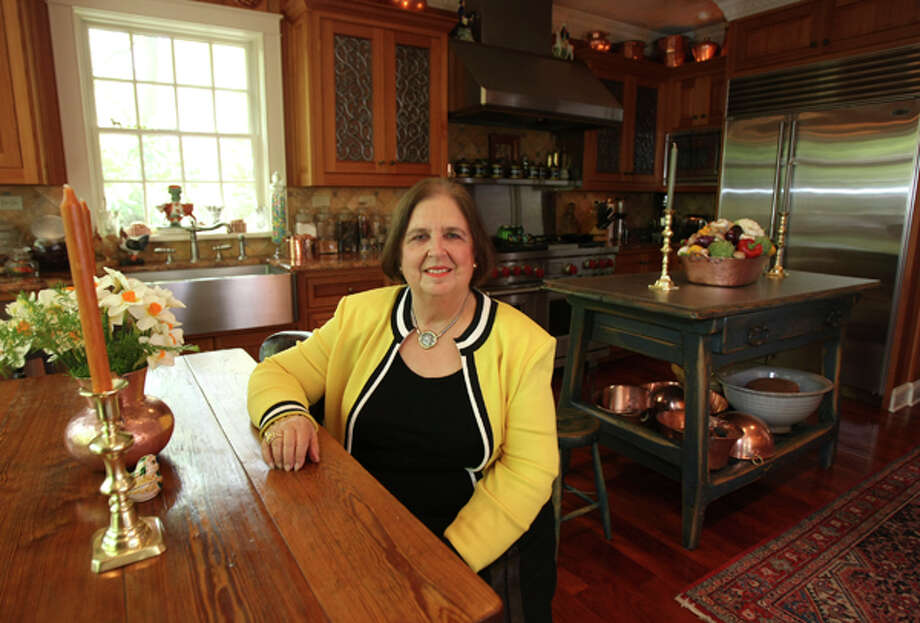 After 20 years in her Alamo Heights home, Maria Luisa Holmgreen expanded her kitchen for cooking and displaying antiques. / hmontoya@express-news.net