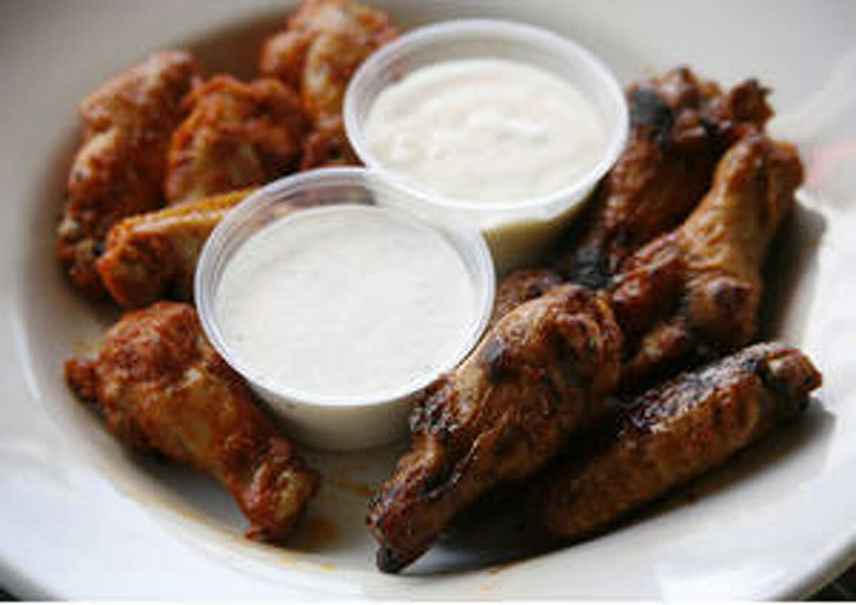Barbecue and hot wings are tender and juicy with lots of flavor. They are served with house-made blue cheese or ranch dressings.