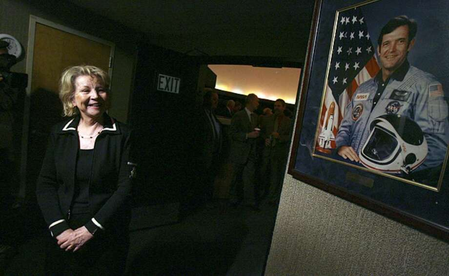 June Scobee Rodgers looks at a portrait of her late husband and Space Shuttle Challenger commander Francis R. 'Dick' Scobee at a press conference at the Scobee Planetarium at San Antonio College on April 26, 2010.