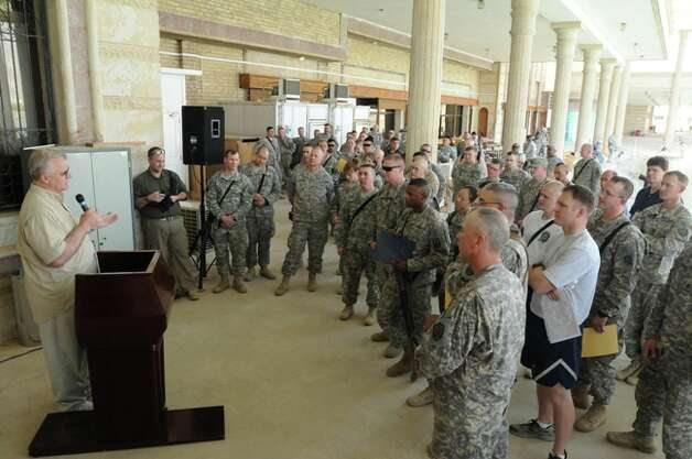 Mike Sherman talks with U.S. troops in Baghdad during his visit there May 5.