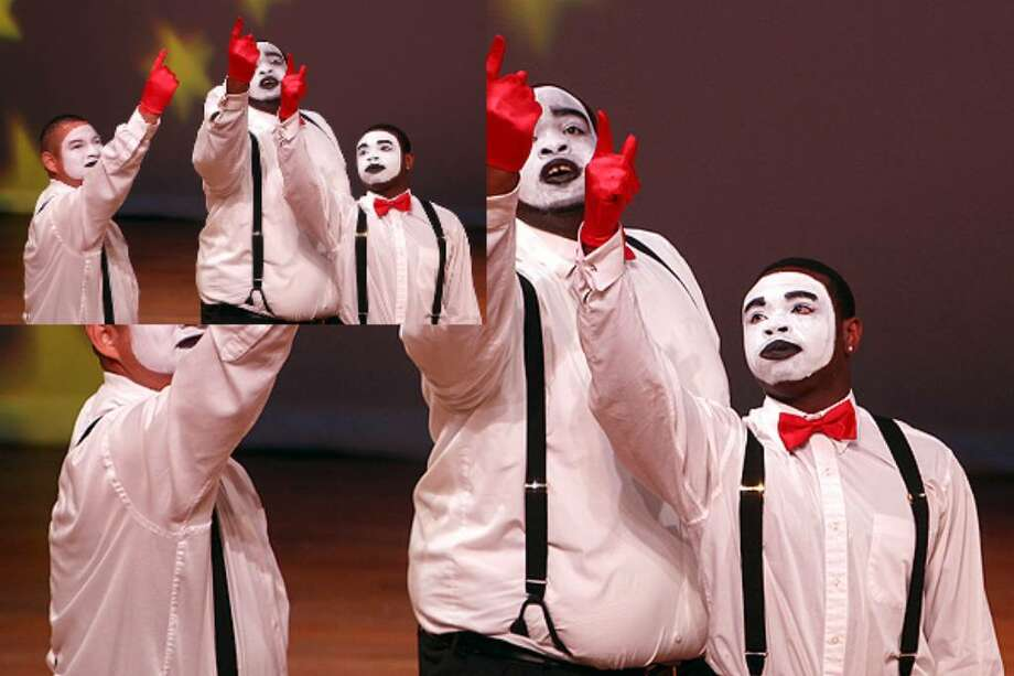 God's Continuous Grace Mime Ministry perform during Fiesta Praise Dance Celebration on Sunday at Carver Community Center. The event was sponsored by Alpha Tau Omega Chapter.