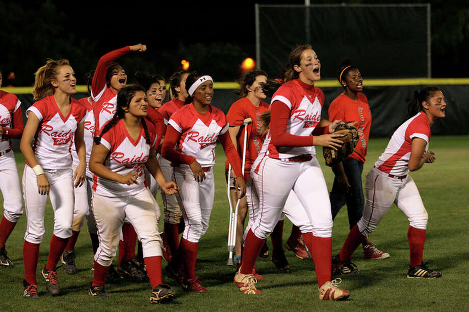 The Taft Raiders celebrate their 2-1 victory over the Brandeis Broncos in Class 5A Softball Regional Quarterfinals Playoff game at Northside Softball Field, Thursday, May 13, 2010. / glara@express-news.net