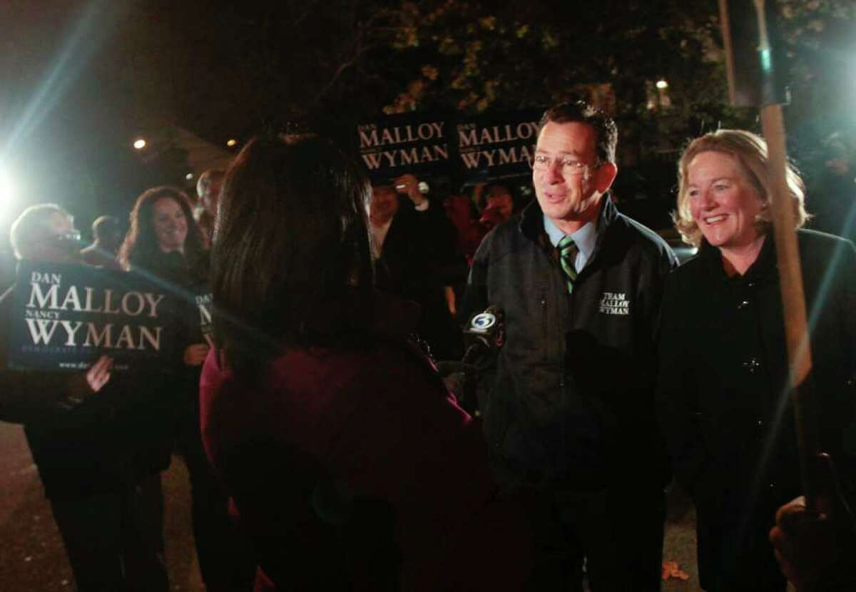 Democratic gubernatorial candidate Dan Malloy, left, and his wife Cathy talk to reporters before voting at Our Lady Star of the Sea on Election Day, Tuesday, Nov. 2, 2010 in Stamford, Conn.