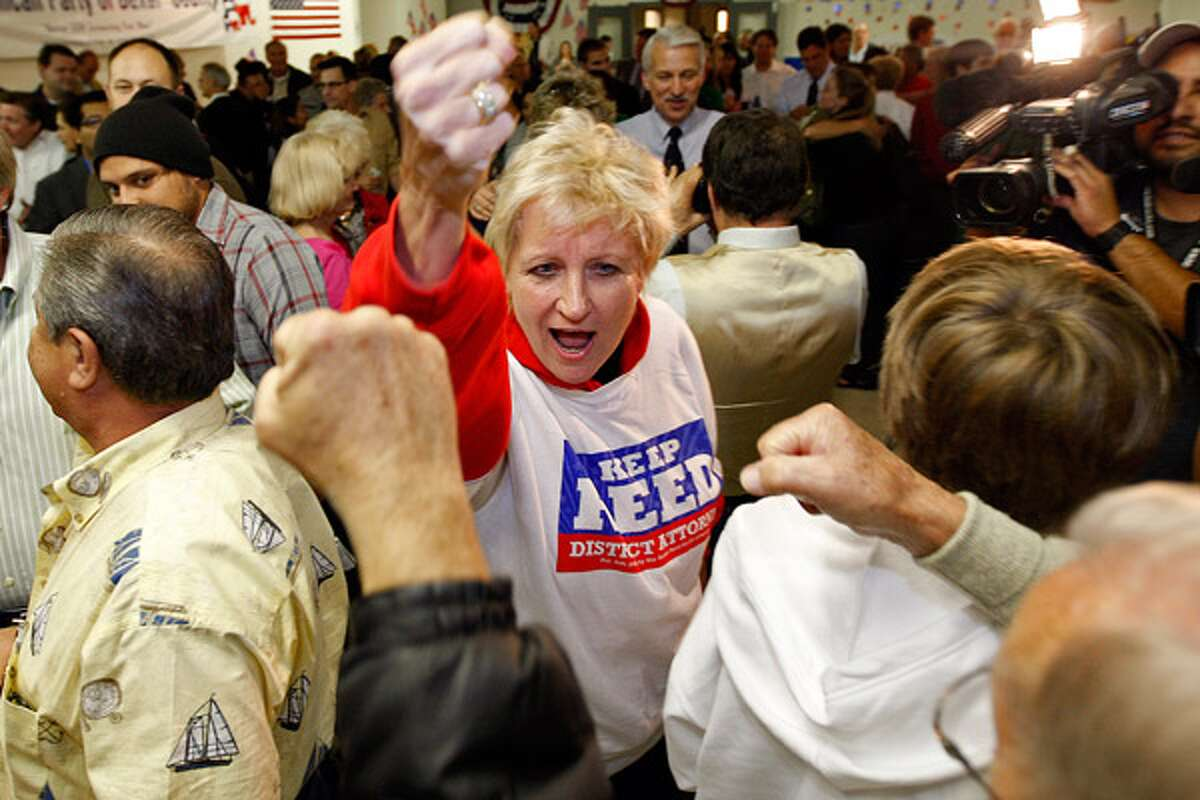 Bexar County District Attorney Susan Reed raises her fist in victory with supporters as she arrives at the Bexar County Republican headquarters.