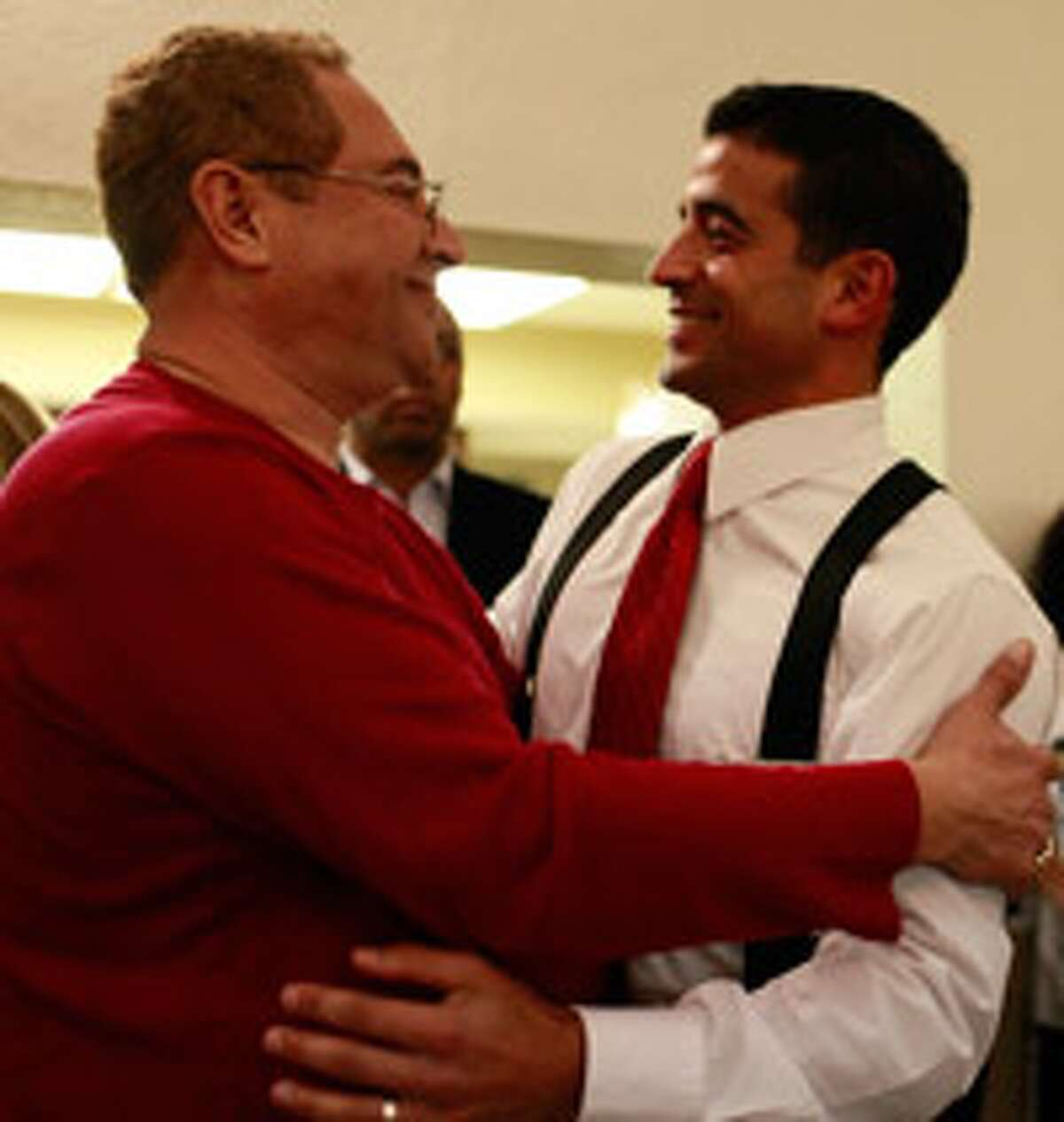 Gerald Flores (left) embraces Nicholas LaHood moments before LaHood addressed his supporters.