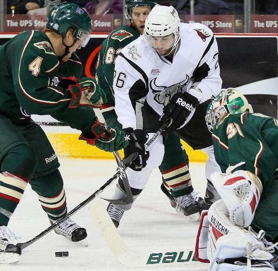 Rampage right wing Mathieu Beaudoin (middle) takes a shot in Friday's victory over the Houston Aeros. His 13 points are tied for the fifth best among AHL players this season.