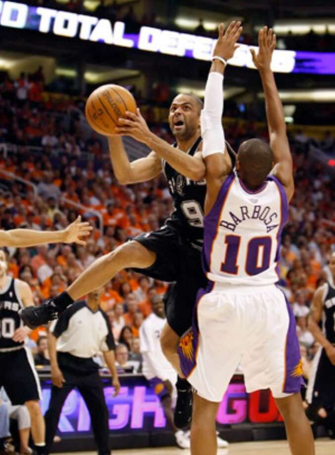 Spurs guard Tony Parker drives around Suns guard Leandro Barbosa during Game 1 on Monday night. Parker had 26 points and put pressure on the Suns' defense — and star point guard Steve Nash — with his drives to the basket.