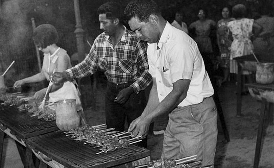 Anticuchos are grilled by the booth at a Night in Old San Antonio in 1967.