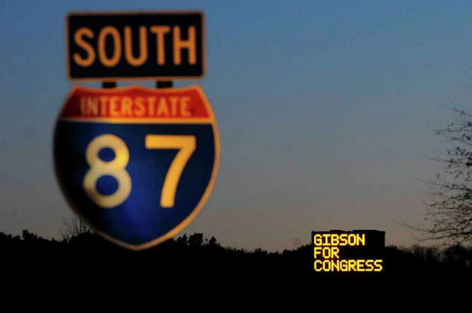 """A flashing DOT-type sign off the Northway's southbound lane is seen just south of exit 13. It reads """"Gibson for Congress"""" and """"Please Vote Today."""" (Michael P. Farrell / Times Union Photo: Michael P. Farrell"""