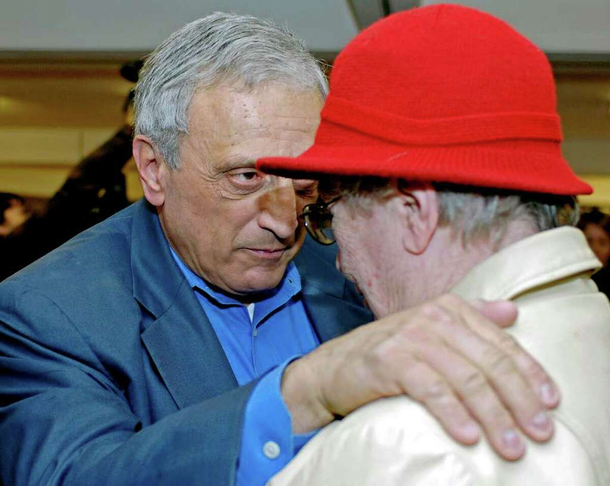 Republican gubernatorial candidate Carl Paladino speaks with a voter Tuesday at his voting district location in Buffalo. (AP Photo/Don Heupel)
