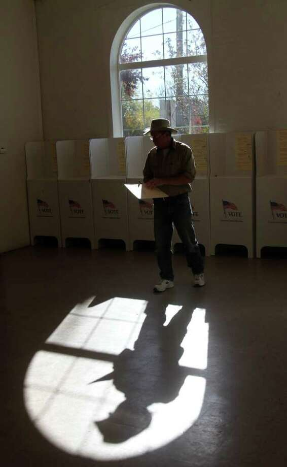Chris Kiser, of Middleton, Idaho, steps away from the polls after casting his ballot in the general election on Tuesday, Nov. 2, 2010, in Middleton, Idaho. (AP Photo/Charlie Litchfield) Photo: Charlie Litchfield