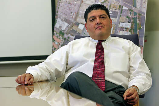 Bexar County Chief Appraiser Michael Amezquita is taking fire from two new members on the appraisal district's board of directors who don't agree with his tough approach.  A battle over tax breaks for affordable housing developers has divided the board of directors at the Bexar Appraisal District and spurred speculation the agency's director could be forced out of his job. / © 2010 San Antonio Express-News