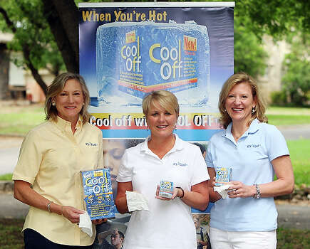 "Deb Bolner Prost's, left, aha! moment came as she searched for something to help beat the heat during one of her daughter's field hockey games. Drinking Gatorade and soaking towels in ice weren't doing the trick, so Prost asked a drugstore clerk what else could help. Nothing, she was told. ""When you ask a question about a product and nobody can answer, it's ding, ding, ding!"" Prost said. Four and a half years after that moment, Prost and her partners, Linda Caldwell, center, and Beverly Bolner  are launching Cool Off, a new product that hit the H-E-B shelves in April. / eaornelas@express-news.net"