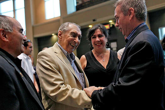 "Michael Gallant, left, producer of ""The Perfect Game,"" talks with C?sar Faz, second from left, and Angel Macias, right, next to Faz's niece Maria Faz Lehman as they arrive at Santikos Silverado 16 for a screening of the movie. More than 50 years after members of a team from Monterrey, Mexico, captivated this nation and theirs by winning the Little League Baseball World Series with a perfect game - the first and only one in championship history - the inspirational story has hit the big screen. / SAN ANTONIO EXPRESS-NEWS"