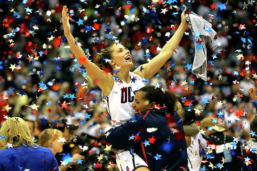 The Connecticut Huskies' Caroline Doty celebrates at the Alamodome  after the Huskies won their second straight NCAA Women's Final Four Championship after beating Stanford.  Connecticut won 53-47 in the first back-to-back undefeated championship seasons in the history of NCAA women's basketball. / glara@express-news.net