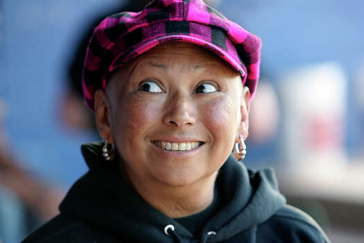 Edison softball coach Mary Ann Villarreal has seen breast cancer spread to her lung, spine and brain, but the disease hasn't penetrated her faith or positive attitude. Despite being on leave from her coaching and teaching positions, Villarreal has been a fixture in the Golden Bears' dugout. / © 2010 San Antonio Express-News