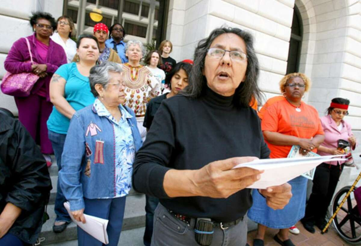 Gloria Ramirez with San Antonio's Esperanza Peace and Justice Center (foreground) speaks during a protest outside the 5th U.S. Circuit Court of Appeals in New Orleans.