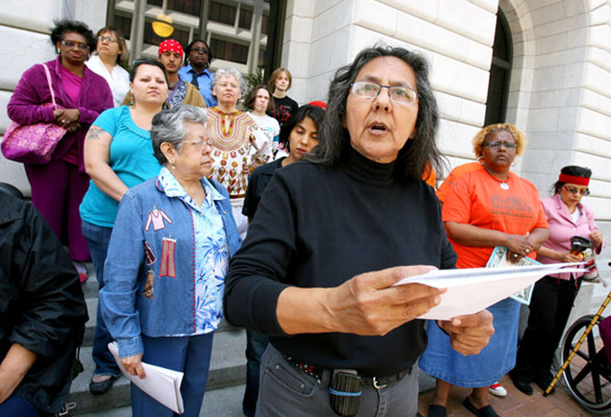 Gloria Ramirez with San Antonio?s Esperanza Peace and Justice Center (foreground) speaks during a protest outside the 5th U.S. Circuit Court of Appeals in New Orleans.