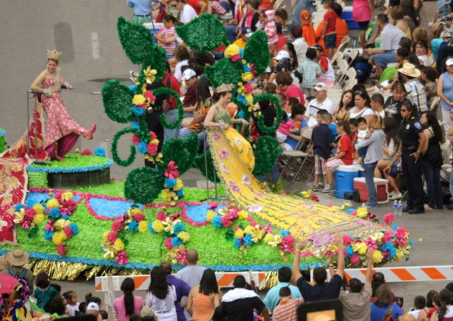 Fiesta duchesses display their footwear during last year's Battle of Flowers Parade. The view is from the St. Anthony Hotel.