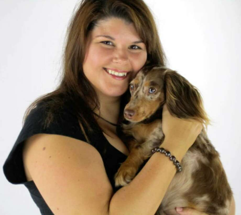 Holly Hirshberg holds Rainbow, who won second place in the Bissell Most Valuable Pet online contest. Rainbow's photo will appear on Bissell products.