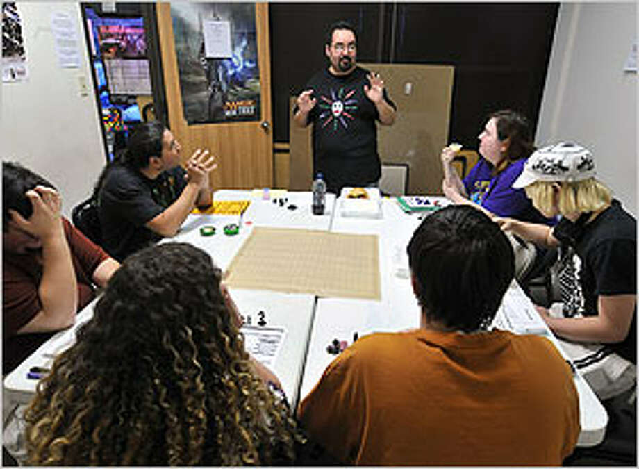As Dungeon Master, George Peña Jr. acts as storyteller and referee. Together, the D&D players at Dragon's Lair Comics & Fantasy on Fredericksburg Road sole problems, engage in battles and collect treasures.