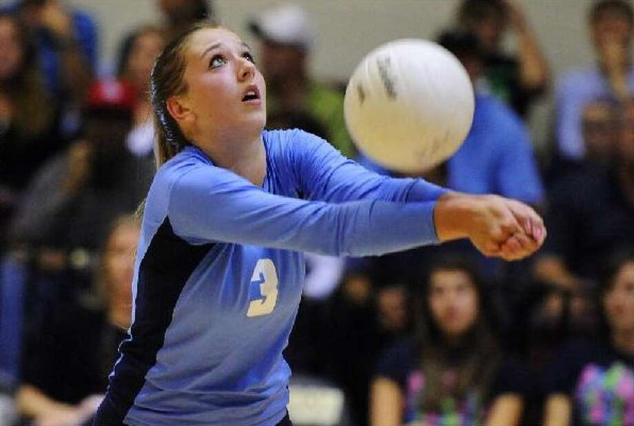 Johnson's Jessica Teel bumps the ball during her team's bidistrict victory over Seguin on Tuesday at Littleton Gym.