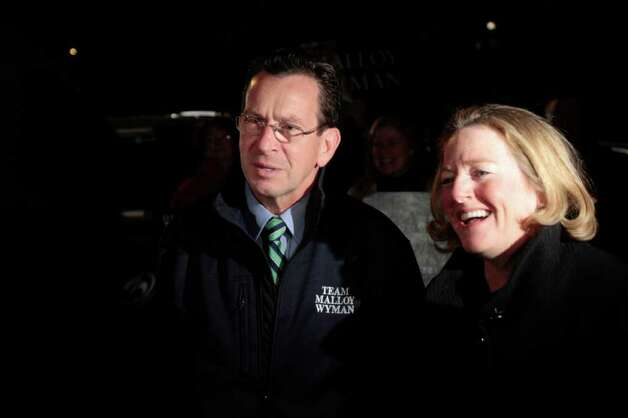 Democratic gubernatorial candidate Dan Malloy, left, and his wife Cathy talk to reporters before voting at Our Lady Star of the Sea on Election Day, Tuesday, Nov. 2, 2010 in Stamford, Conn. Photo: Chris Preovolos / Stamford Advocate