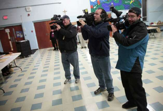 Television cameramen tape Democratic gubernatorial candidate Dan Malloy as he prepares to vote at Our Lady Star of the Sea on Election Day, Tuesday, Nov. 2,