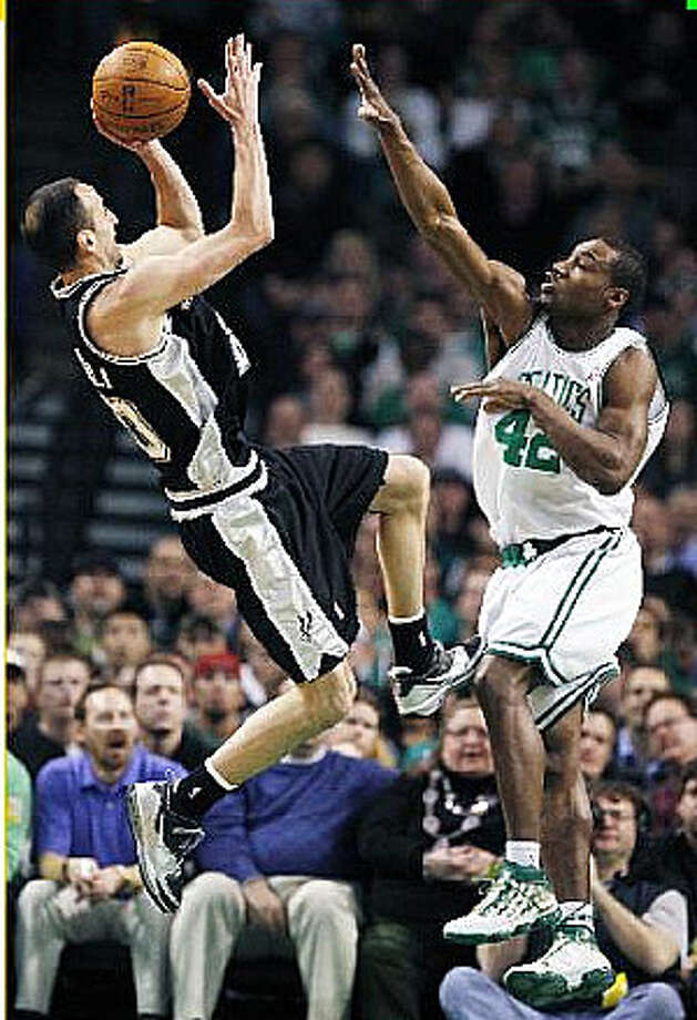 Spurs guard Manu Ginobili (left) shoots a fall-away jumper over the Celtics? Tony Allen.