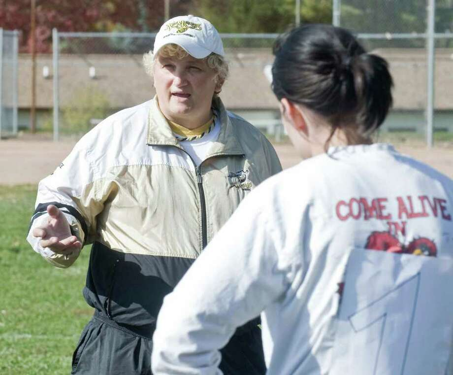 The Northeastern Nitro women's tackle football team co-owner Carley Pesente of Bethel talks with a group of women trying out for the team at Frank A. Berry School in Bethel. Saturday, Oct 23, 2010 Photo: Scott Mullin / The News-Times Freelance