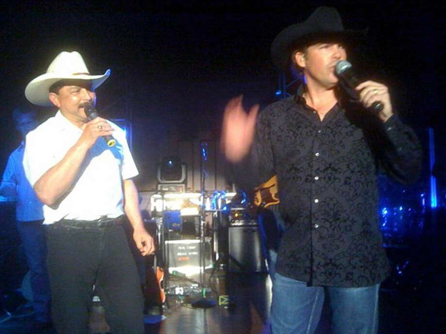 Grammy-winning Tejano singer Emilio Navaira, left, performs Saturday night during a fundraiser at the Pearl Stable with singer Clay Walker. It was Emilio's first public performance since 2008.