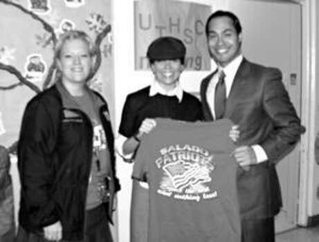 East Central ISD's Lesley Balido-Dean is pictured with Mayor Julian Castro and Principal Ashley Chohlis.